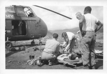 Wounded being evacuated 46th MASH, Korea, July '53