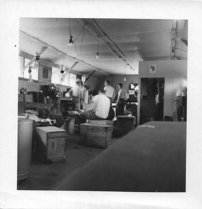 Lab at the 46th MASH, wounded on the boxes receiving blood, July '53