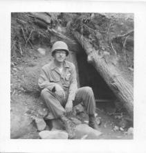 Norm Dial in front of bunker, Christmas Hill, Korea, 1953