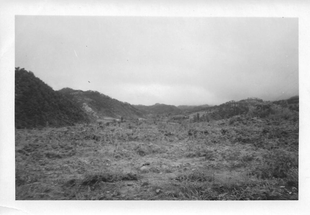Looking towards the battlefront, first day of the Kumsong Offensive by the Chinese. Note hazy sky. Korea, July 1953