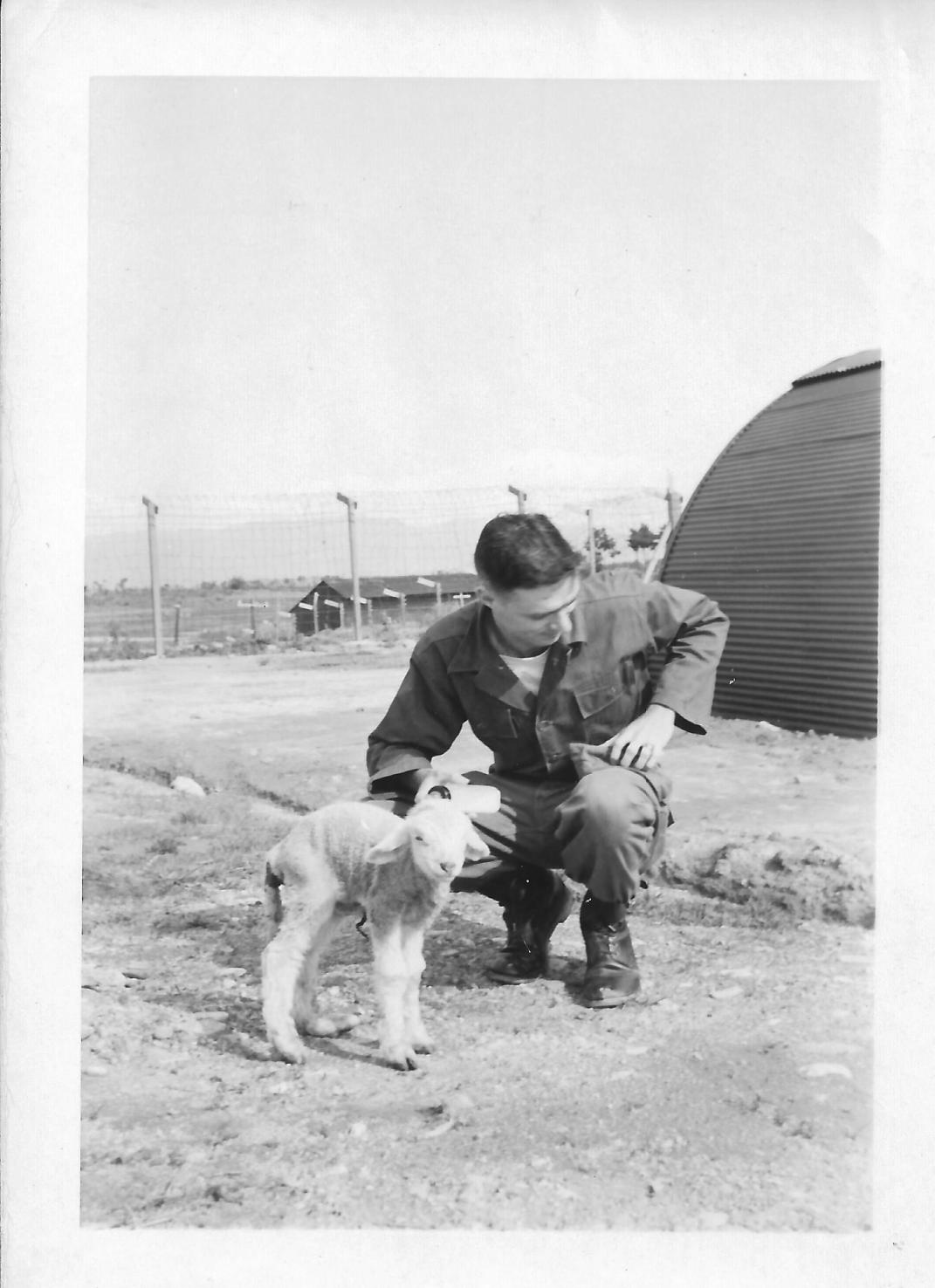 "Don Feeney and pet lamb ""Stinky"" 48th MASH, Korea,"