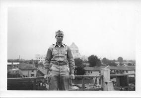 Don Feeney on roof of Finance Building, Diet Building in back, Tokyo, 1953
