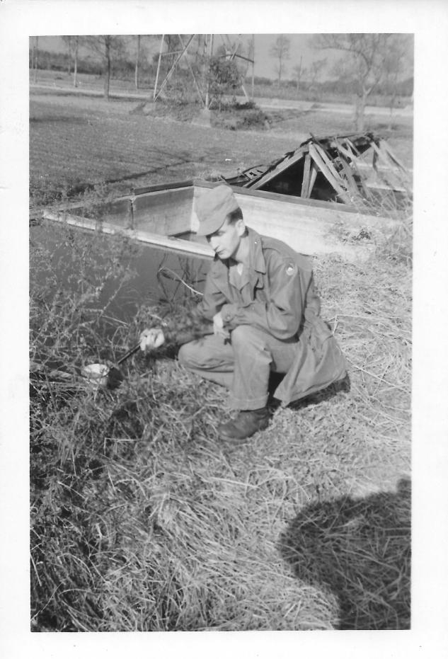 Stan Ennis dipping for mosquito larvae, Japan, 1953